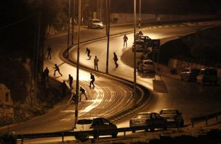 Palestinians and Israeli Security Forces in Surda