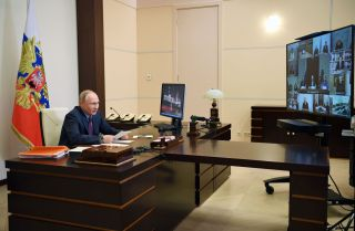 Russian President Vladimir Putin chairs a meeting of the Presidential Council for Civil Society and Human Rights via a video conference call Dec. 10, 2020, at the Novo-Ogaryovo state residence outside Moscow.