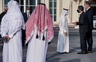 U.S. Secretary of State Antony Blinken speaks with Qatari government officials before boarding an aircraft in Doha on Sept. 8, 2021.