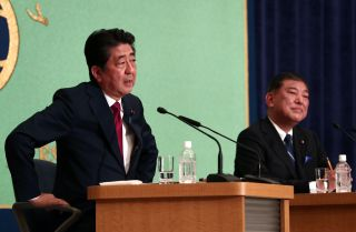 Japanese Prime Minister Shinzo Abe, left, and former Defense Minister Shigeru Ishiba debate in Tokyo on Sept. 14, 2018.