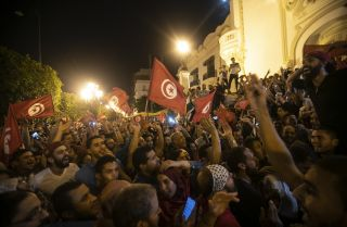 In this photo, Tunisians celebrate Kais Saied's victory in Tunisia's presidential election on Oct. 13, 2019.