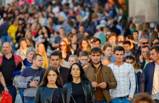 A crowd of people walks down the street in Moscow in September 2017.