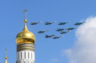Russian Su-35 and Su-34 aircraft fly over central Moscow on May 4, 2017, during a rehearsal for the country's annual Victory Day military parade.