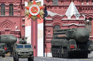 An intercontinental ballistic missile launcher and an armored vehicle are displayed during a military parade in Moscow, Russia, on June 24, 2020, to commemorate the 75th anniversary of Russia's victory in World War II.