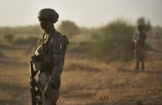 French soldiers monitor an area along Burkina Faso's border with Mali and Niger on Nov. 10, 2019.