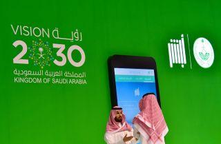 A display promotes Saudi Arabia's Vision 2030 economic reform campaign at the 2017 GITEX technology exhibition in Dubai, United Arab Emirates.