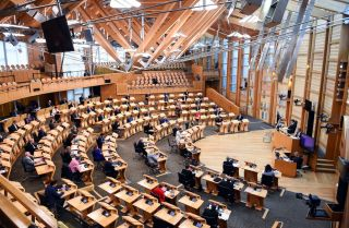 First Minister of Scotland Nicola Sturgeon delivers a speech to the Scottish Parliament in Edinburgh on Sept. 1, 2020.