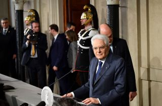 Italian President Sergio Mattarella delivers remarks to journalists as he and the leaders of Italy's political parties negotiate a path toward forming a government.