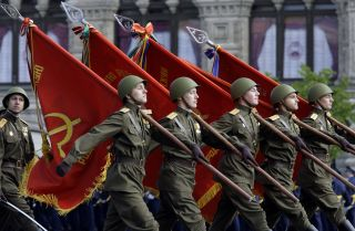 Soldiers march in the Victory Day military parade.
