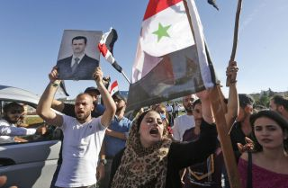 A rally in support of Syrian President Bashar al-Assad on June 11, 2020, at Umayyad Square in Damascus, Syria.