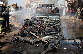 A vehicle destroyed in a bombing is seen in Syria's rebel-held northern city of Afrin on Oct. 11, 2021.