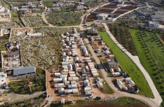 An ariel view shows a camp in Idlib for people displaced by Syria's ongoing civil war on April 13, 2021.