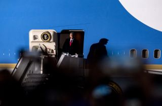 U.S. President Donald Trump exits Air Force One upon arriving in Duluth, Minnesota, for a campaign rally on Sept. 30, 2020. The following night, Trump tested positive for COVID-19.