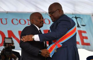 Outgoing Democratic Republic of the Congo President Joseph Kabila (L) embraces newly inaugurated President Felix Tshisekedi on Jan. 24, 2019, in Kinshasa.
