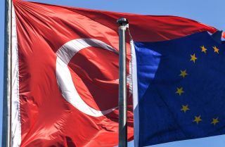 The Turkish and EU flags Aug. 15, 2018, in Istanbul's financial and business district of Maslak.