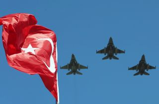 The Turkish Stars, the aerobatic demonstration team of the Turkish Air Force and the national aerobatics team of Turkey, perform Aug. 30, 2015, during the ceremony marking the 93rd anniversary of Victory Day, at Anitkabir, Ataturk's mausoleum, in Ankara.