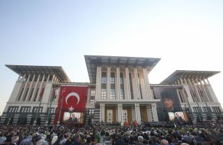 Turkish President Recep Tayyip Erdogan addresses the crowd gathered before Ankara's Presidential Palace on July 9, 2018, the day of his inauguration for another term in office.