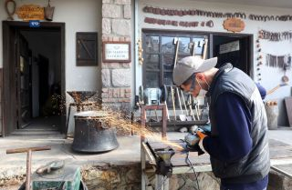 A blacksmith crafts metal in a village mansion in Ankara, Turkey, on Nov. 18, 2020.