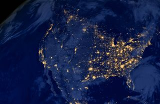 A satellite image of the United States at night.