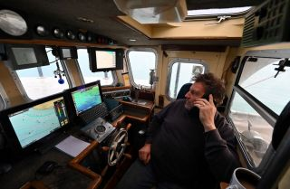 The skipper of a fishing boat on Oct. 12, 2020, off the southeast coast of England.