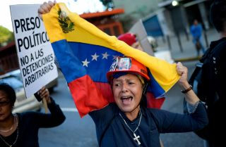 An anti-government protestor in Venezuela demonstrates in memory of jailed protestors and those harmed by protests.