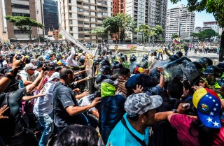 A default by Petroleos de Venezuela on its debt would likely hamper oil production, leading to tighter food supplies and stirring up further unrest in Venezuela.