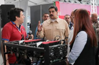 President Nicolas Maduro (C) of Venezuela attends the International Science and Technology Fair in Caracas on Dec. 3.
