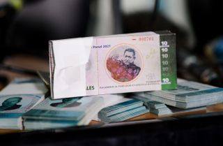 A collective in a hilltop shantytown in Caracas created its own currency, the panal, to fight chronic shortages of cash in inflation-ridden Venezuela.
