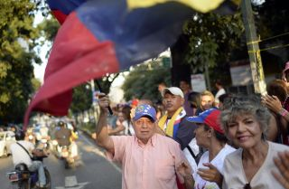 Opponents of Venezuela's constitutional assembly rally in Caracas after a symbolic vote against the measure. The vote to authorize the body that will rewrite the country's constitution will be held July 30.