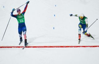U.S. cross-country skier Jessica Diggins (L) crosses the finish line ahead of Swedish skier Stina Nilsson to win gold in the sprint event at the Winter Olympics in Pyeongchang, South Korea.