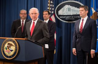 Former U.S. Attorney General Jeff Sessions announces the creation of a new initiative to crack down on Chinese intelligence officials stealing intellectual property from U.S. corporations through hacking and espionage during a press conference at the Justice Department on Nov. 1, 2018.