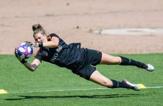 Netherlands goalkeeper Lize Kop works out before her team's appearance in the Women's World Cup championship game