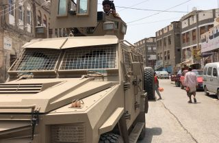 A member of the southern separatist movement rides an armored military vehicle in Aden, Yemen, on Aug. 11, 2019.