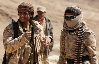 Yemeni fighters loyal to internationally recognized President Abd Rabboh Mansour Hadi stand guard near Sanaa, the capital city, in February 2018.