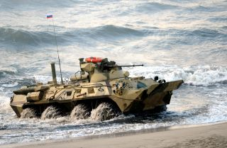 A Russian-built BTR-82A amphibious armored personnel carrier lands on the shore during 2013 joint military exercises with Belarus in the Russia's Kaliningrad enclave.