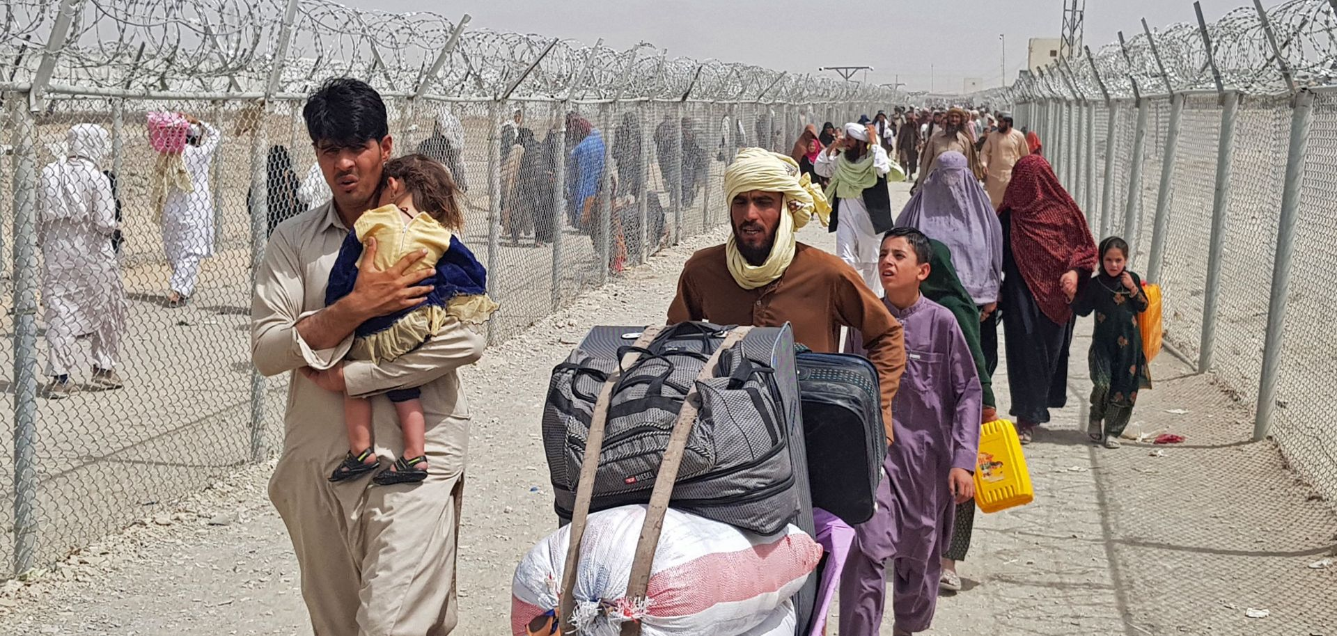 Stranded Afghan nationals arrive to return back to Afghanistan at the Pakistan-Afghanistan border crossing point in Chaman on Aug. 16, 2021.