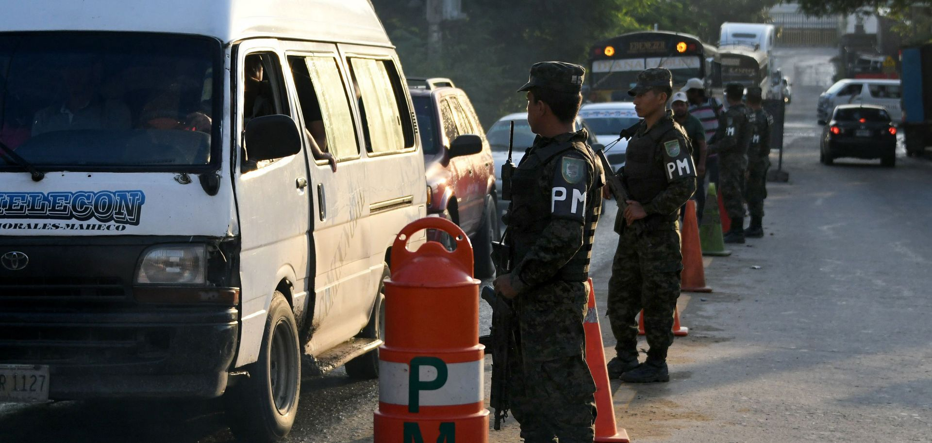 A military police checkpoint in November 2017 in San Pedro Sula, Honduras. The underlying condition that enables the extreme violence of the country's homicide highways is the region's geography.