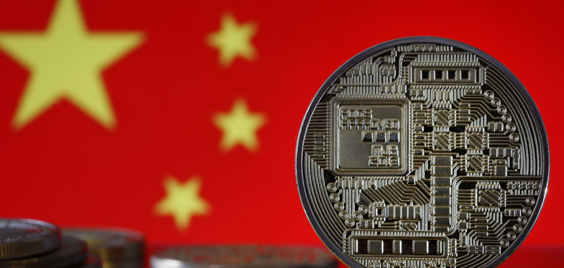 A photo illustration shows digital currency coins in front of a Chinese flag in October 2019.
