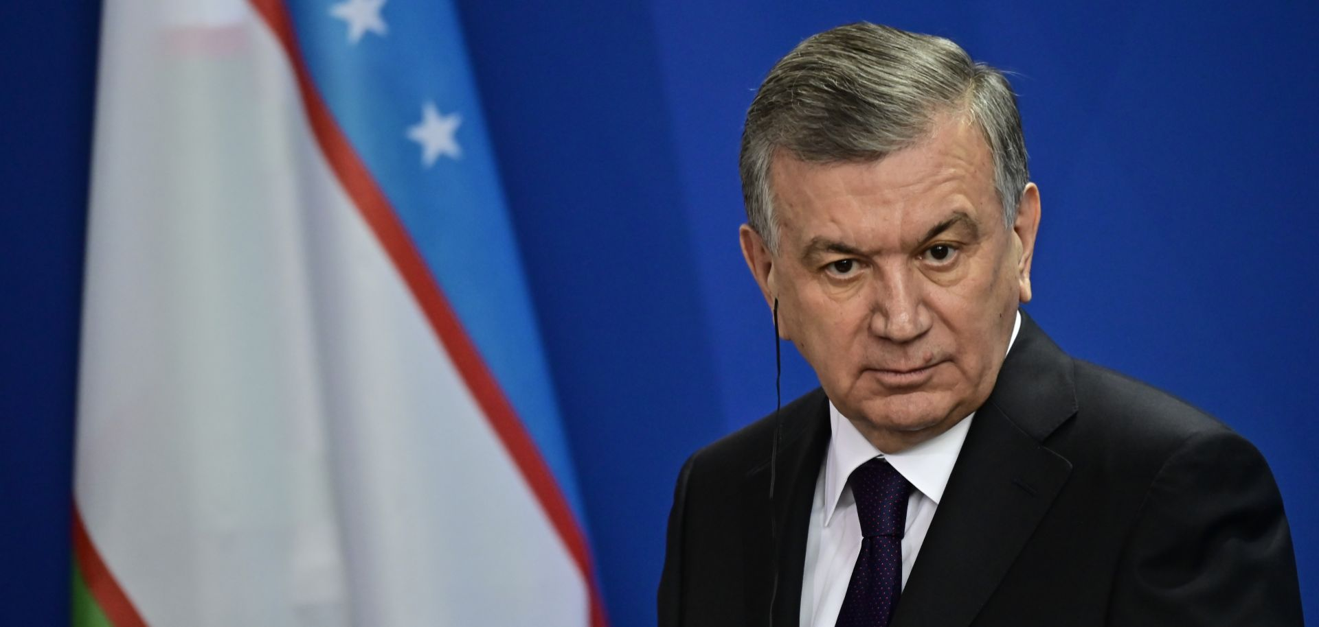 Uzbek President Shavkat Mirziyoyev listens during a joint press conference with German Chancellor Angela Merkel prior to a meeting on Jan. 21, 2019, in Berlin.