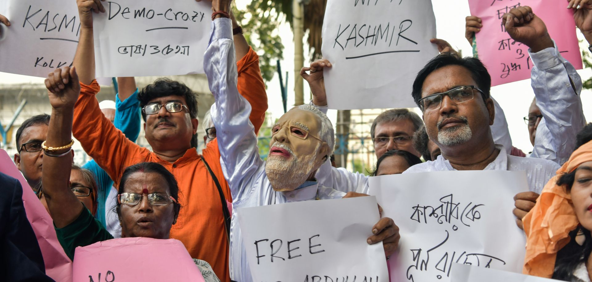 Demonstrators hold placards while shouting slogans during a protest in Kolkata on Aug. 5 at New Delhi's move to revoke Kashmir's autonomy for Jammu and Kashmir.