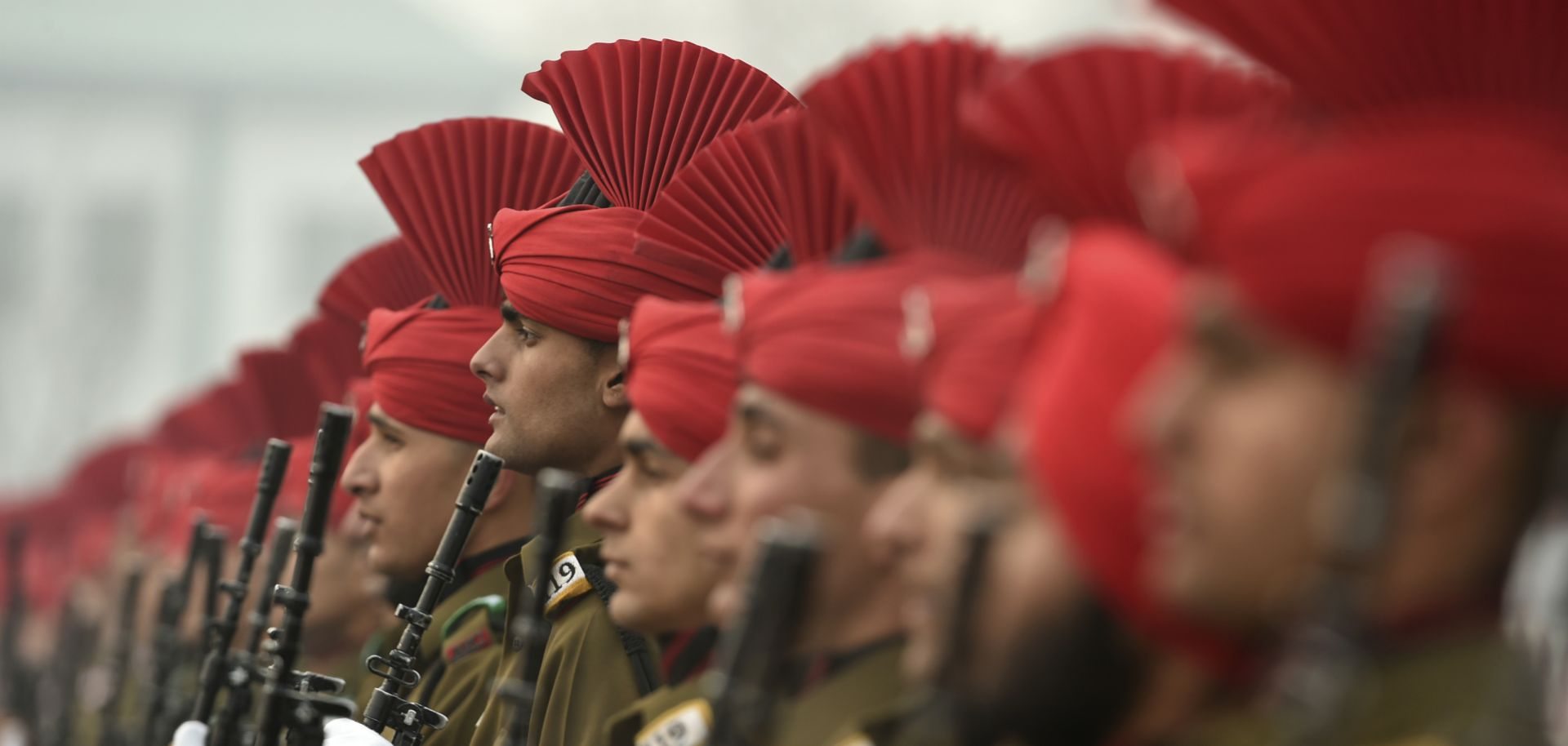 Newly recruited Indian army soldiers from the Jammu and Kashmir Light Infantry (JAKLI) stand in formation during a passing out parade at JAKLI army headquarters in Srinagar on Dec. 7, 2019.