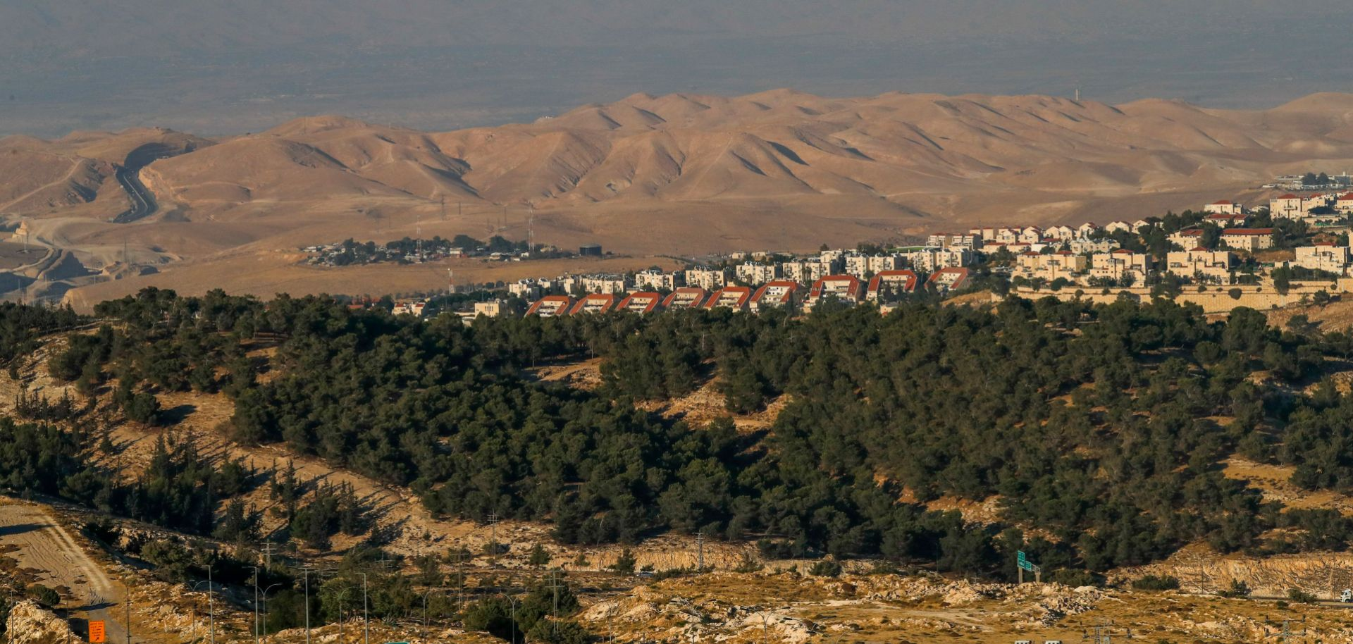 The Israeli settlement of Ma'ale Adumim is seen in the background of the photo of the West Bank's E1 corridor taken on June 30, 2020.