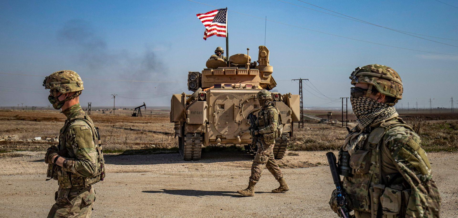U.S. soldiers patrol oil fields in northeast Syria on Feb. 13, 2021.