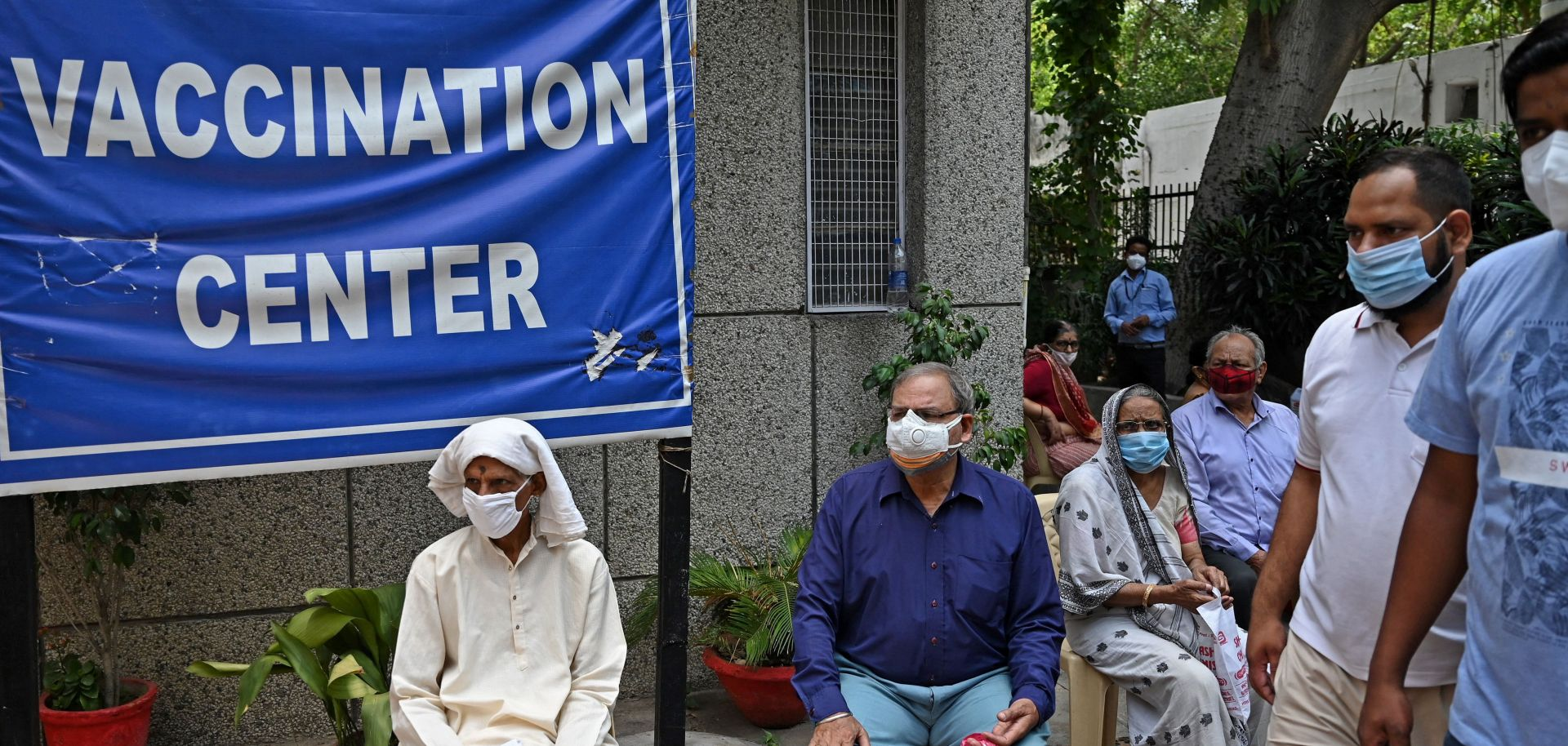 People wait to receive COVID-19 vaccines at a health center in New Delhi on May 13, 2021.