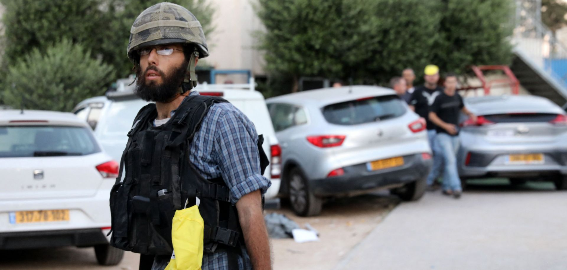 An Israeli far-right extremist walks in the street following clashes in the mixed Arab-Jewish city of Lod on May 13, 2021.