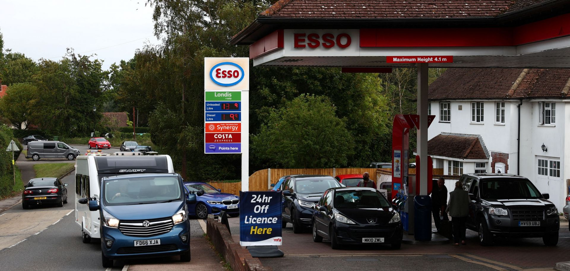 Cars line up at a gas station in the U.K. village of Odiham amid fuel shortages on Sept. 30, 2021.