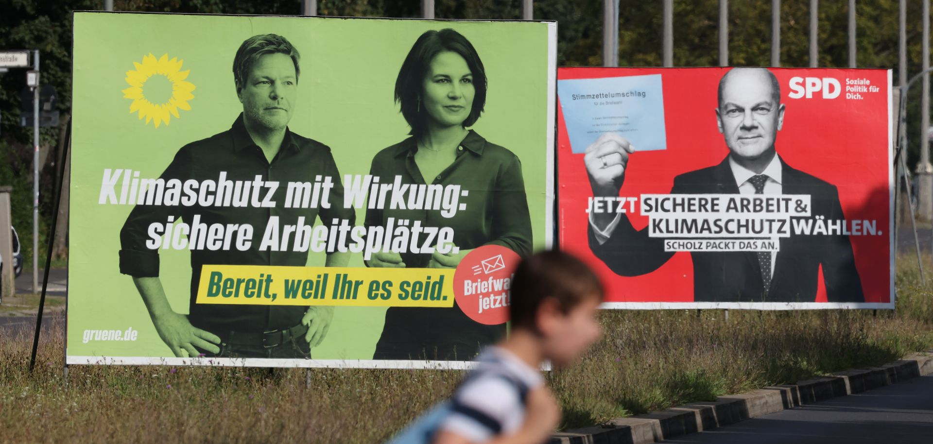 Campaign billboards in Berlin show the chancellor candidates for Germany's Green party (left) and Social Democratic Party on Aug. 24, 2021.