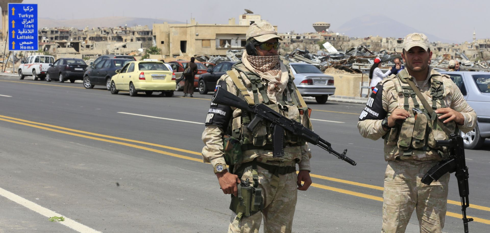 In this photograph, Russian military police guard a road outside Damascus, Syria, after it reopened May 15, 2018.
