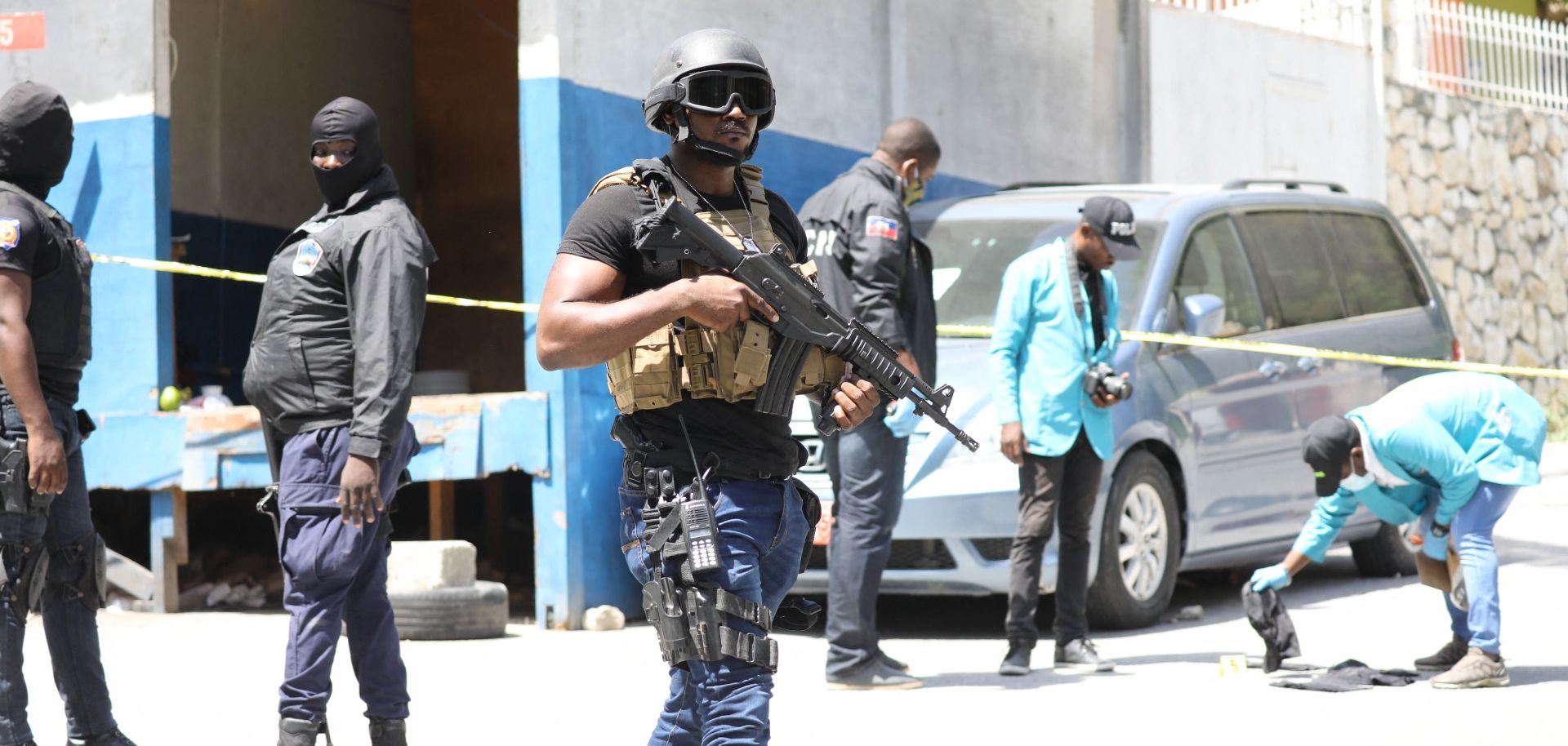 Haitian security forces look for evidence outside of President Jovenel Moise's residence in Port-au-Prince following his assassination on July 7, 2021.