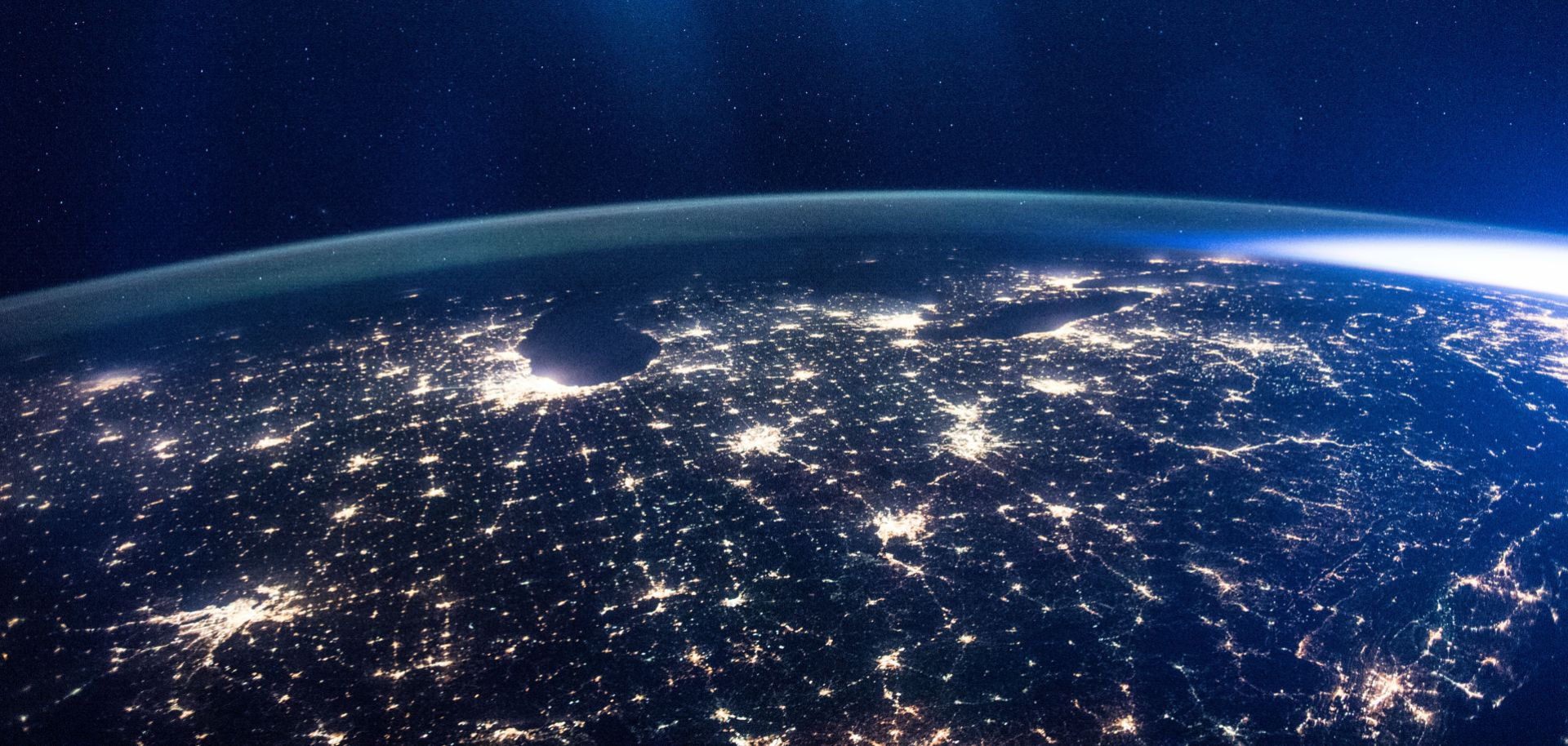 The glittering lights of the American Midwest illuminate the Earth in this captivating image taken by the International Space Station Expedition 46 crew on Jan. 5, 2016. The picture, which was taken while the station was flying above Alabama, shows numerous major cities, including the major city of Chicago (middle-left) situated on the Lake Michigan coastline. Also in view are three of the American Great Lakes, including Lake Michigan (left), Lake Huron (middle) and Lake Erie (right).